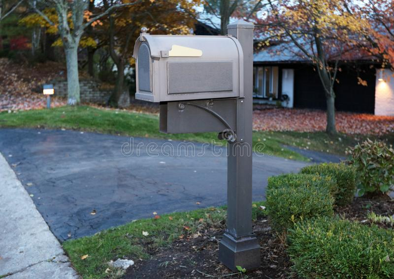 Beautiful grey mailbox in american suburb stock photography