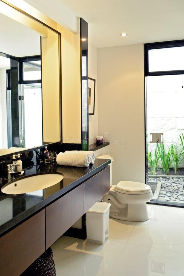 Beautiful grey new modern bathroom interior. Bathroom interior with glass shower and tub stock photo
