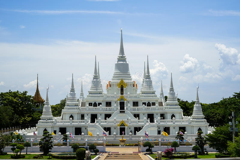 Beautiful group of white pagoda, Thutangkachedi, stupa with multiple spires of Wat Asokaram on sunny day royalty free stock image