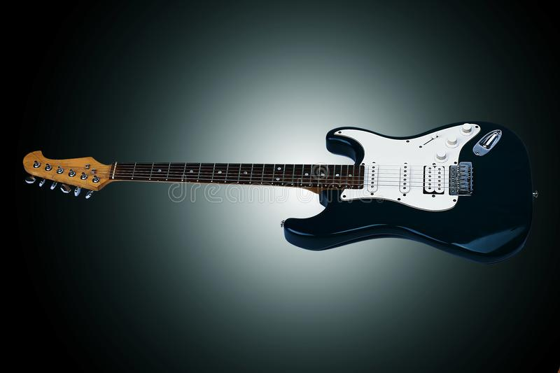 Beautiful guitar. Isolated on a black background. Beautiful guitar. Isolated on a black background with vignette royalty free stock photos
