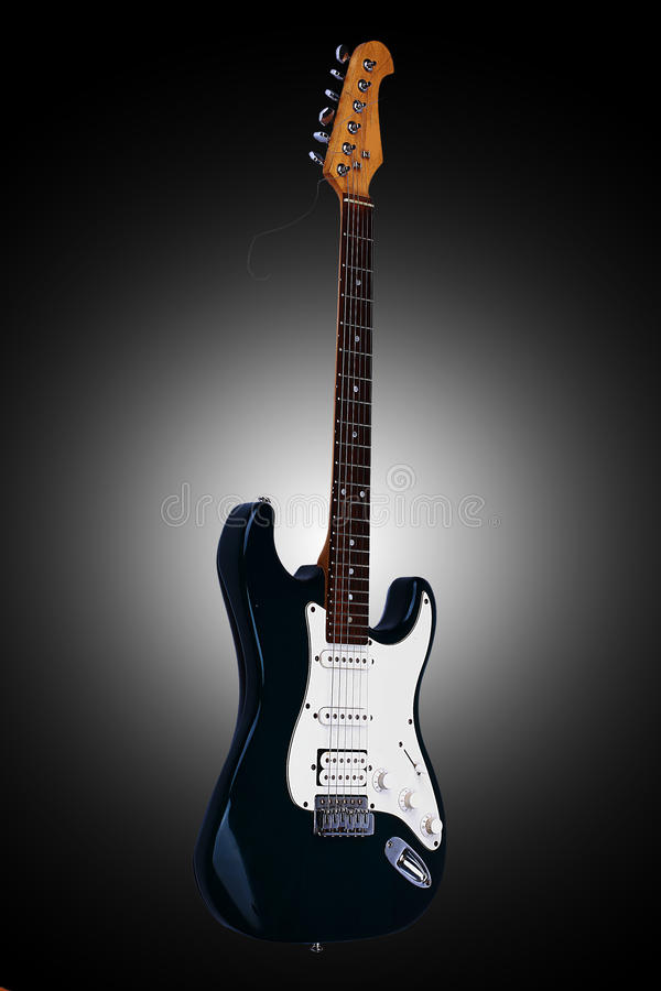 Beautiful guitar. Isolated on a black background. Beautiful guitar. Isolated on a black background with vignette royalty free stock images