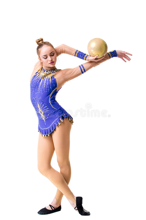 Beautiful gymnast athlete teenage girl wearing dancer blue leotard working out, doing exercise with ball. isolated. Beautiful gymnast athlete teenage girl royalty free stock photography