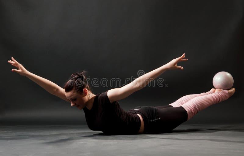 Beautiful gymnast with ball stock photo