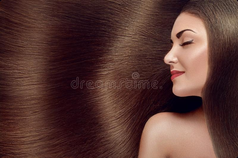 Beautiful Hair. Beauty woman with luxurious long hair as background. Beauty Model Girl with Healthy brown Hair. Pretty female with stock images