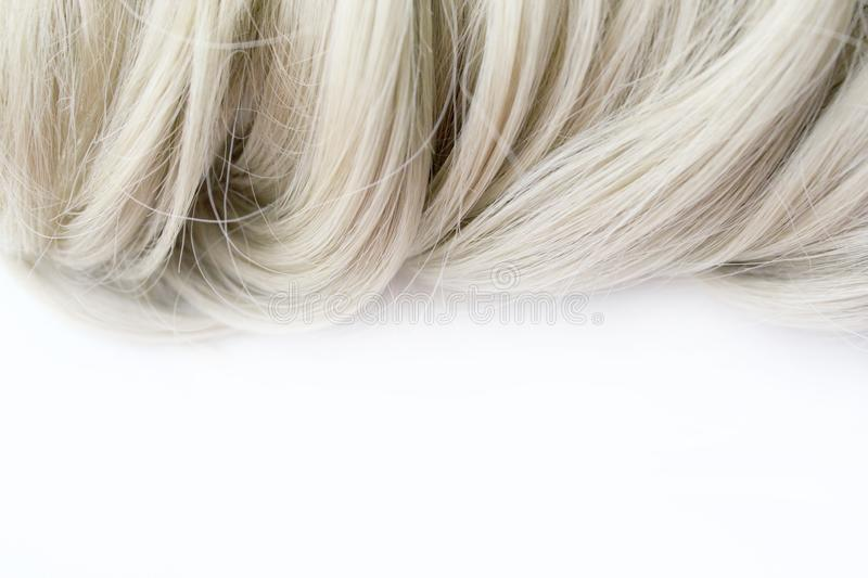 Beautiful hair. Light brown hair. Hair is gathered in a bun on a white background. With free space for text. For a poster or busin royalty free stock image
