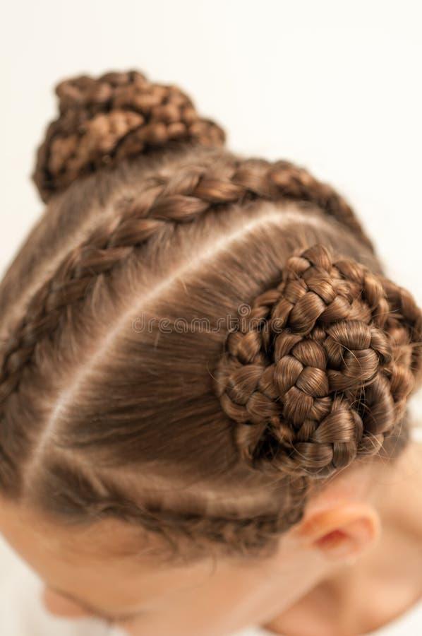 Braids on a girl. Beautiful hair weave on a girl with dark hair stock photos