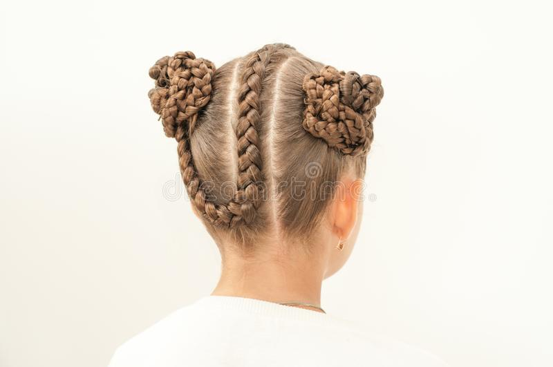 Braids on a girl. Beautiful hair weave on a girl with dark hair stock photography