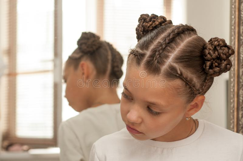 Braids on a girl. Beautiful hair weave on a girl with dark hair royalty free stock photo