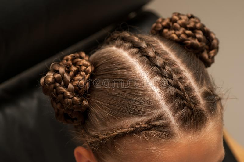 Braids on a girl. Beautiful hair weave on a girl with dark hair royalty free stock image