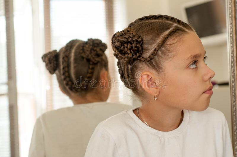 Braids on a girl. Beautiful hair weave on a girl with dark hair royalty free stock photography