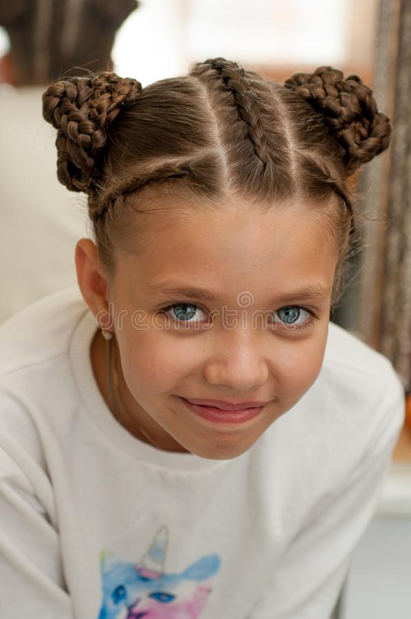 Braids on a girl. Beautiful hair weave on a girl with dark hair stock image