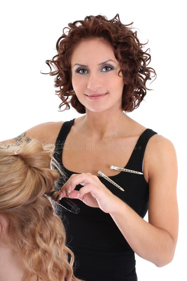 Beautiful hairdresser with client over white royalty free stock photo