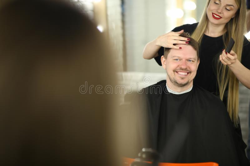 Beautiful Hairdresser Making Man Client Hairstyle stock photo