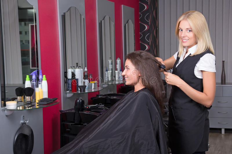 Beautiful Hairdresser Working In Beauty Salon Stock Photography