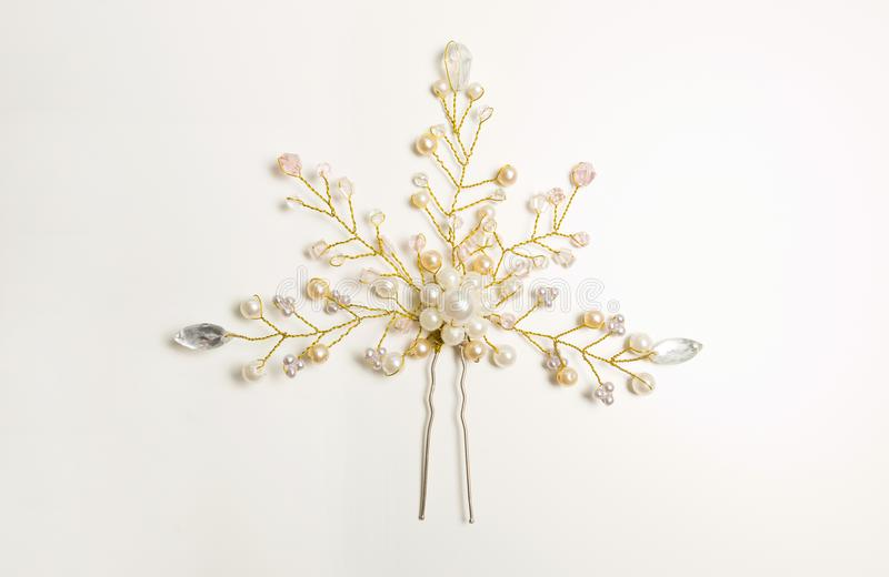 Beautiful hairpin decorated white pearls over a white background royalty free stock image