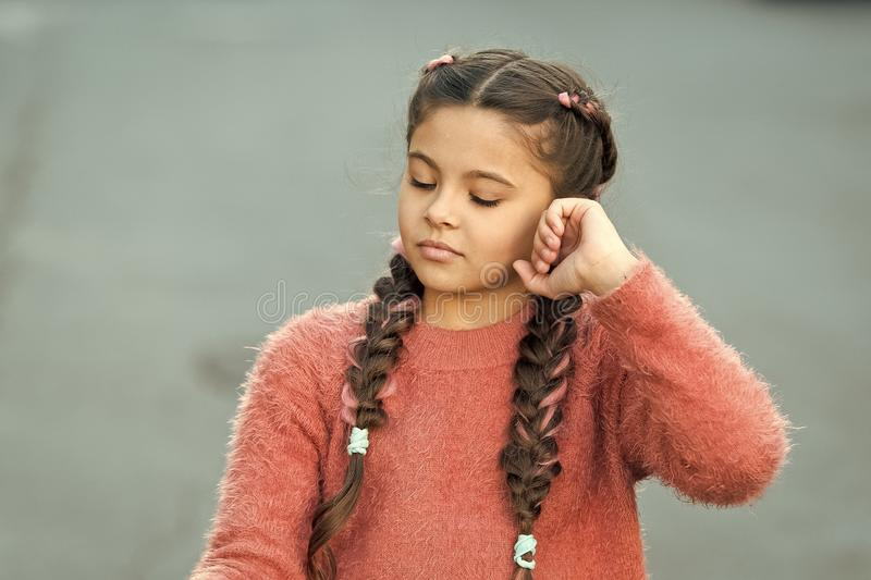 Beautiful hairstyle. Fashionable hairstyle for kids. Small girl with fashionable braids hairstyle. Fashion trend. Salon royalty free stock photography