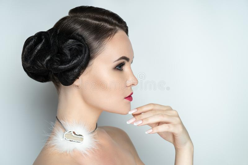 Beautiful hairstyle makeup manicure stock photos