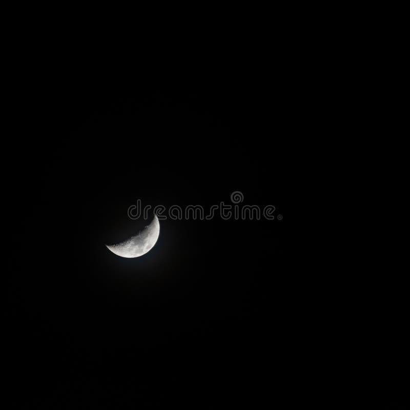 Beautiful half moon in the pitch black dark sky stock photography