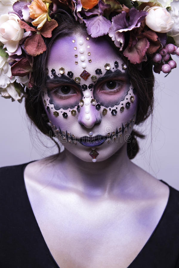 Beautiful Halloween Girl with Rhinestones and Wreath of Flowers royalty free stock photo