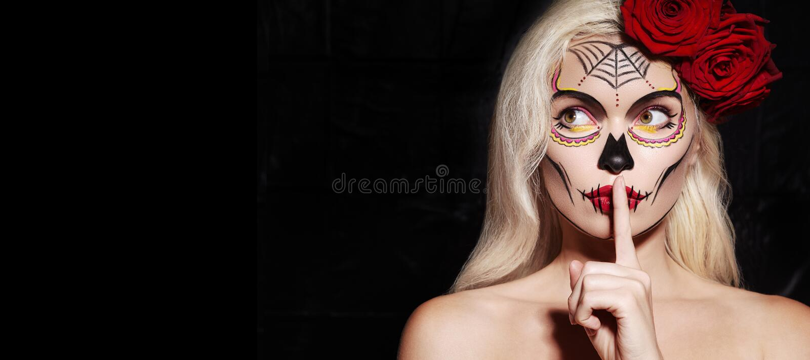 Beautiful Halloween Make-Up Style. Blond Model Wear Sugar Skull Makeup with Red Roses. Santa Muerte concept stock photos