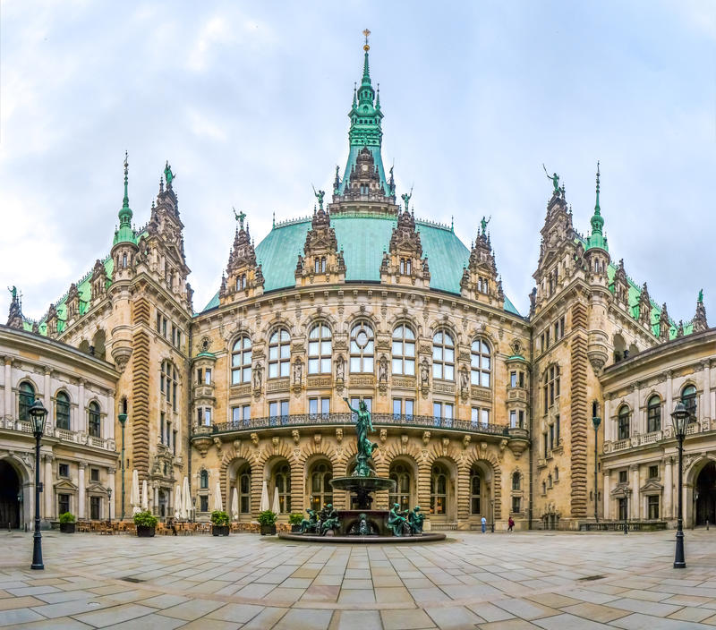 Beautiful Hamburg town hall with Hygieia fountain from courtyard, Germany. Beautiful view of famous Hamburg town hall with Hygieia fountain from courtyard near royalty free stock images