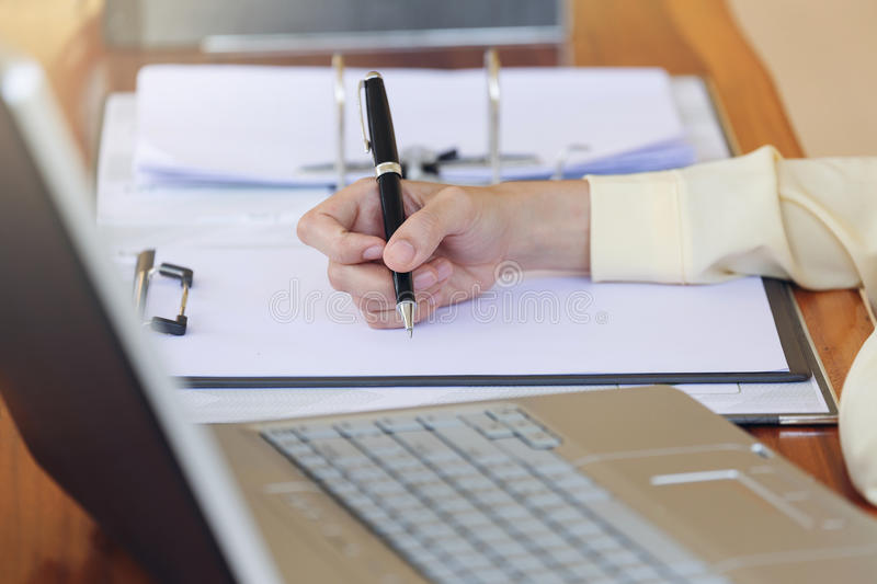 Beautiful Hand business woman working with pen writing on white stock photography