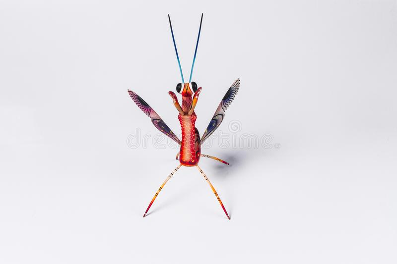 Mexican red mantis alebrije isolated in white background view from above stock photography