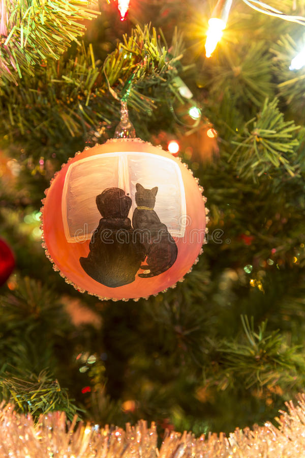 Beautiful hand made glass ball with animals on Christmas Tree stock images