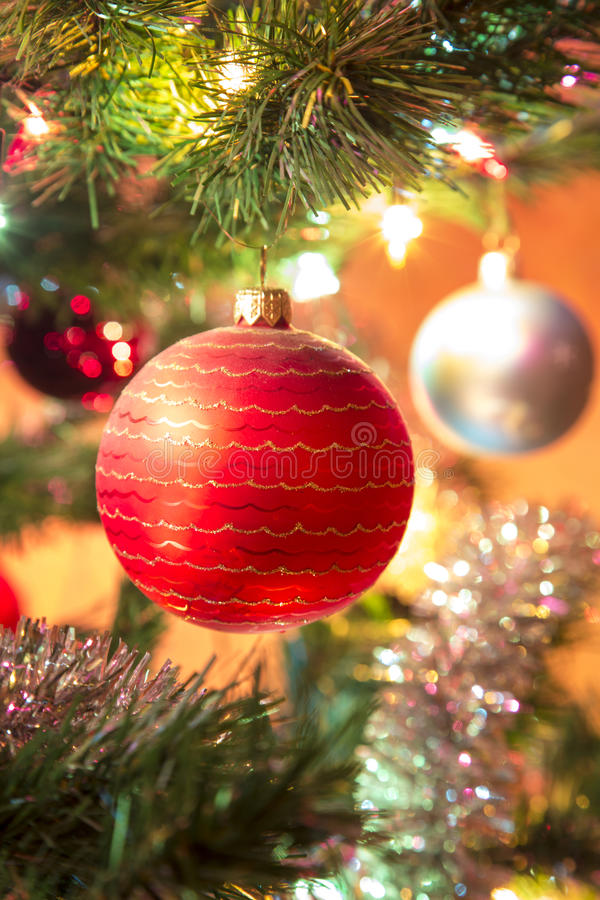 Beautiful hand made glass ball on Christmas Tree stock image