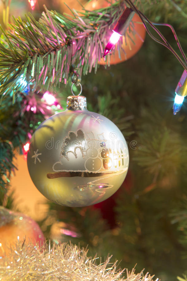 Beautiful hand made glass ball on Christmas Tree royalty free stock image
