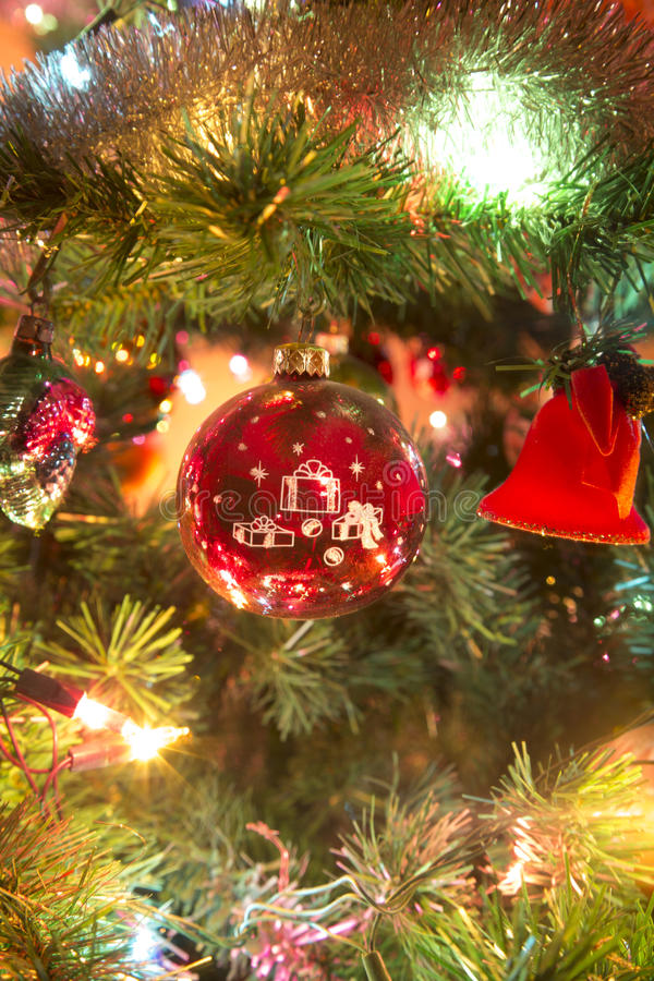 Beautiful hand made glass ball on Christmas Tree royalty free stock images