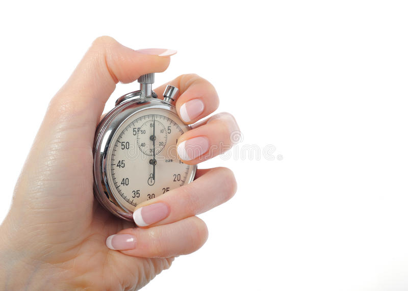 Beautiful hand with stop watch royalty free stock images