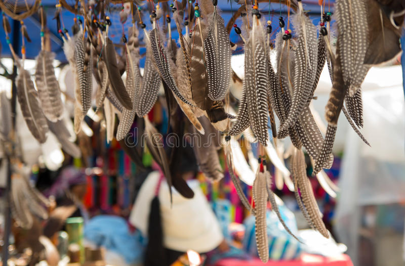 A beautiful handicrafts made of feather. with a blurred market background royalty free stock photos