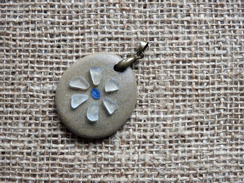 Handmade pendant using sea glass and sea stone , Lithuania stock photos