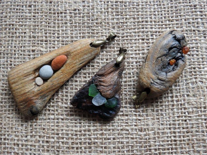 Handmade pendant using sea glass and sea stone , Lithuania stock photo