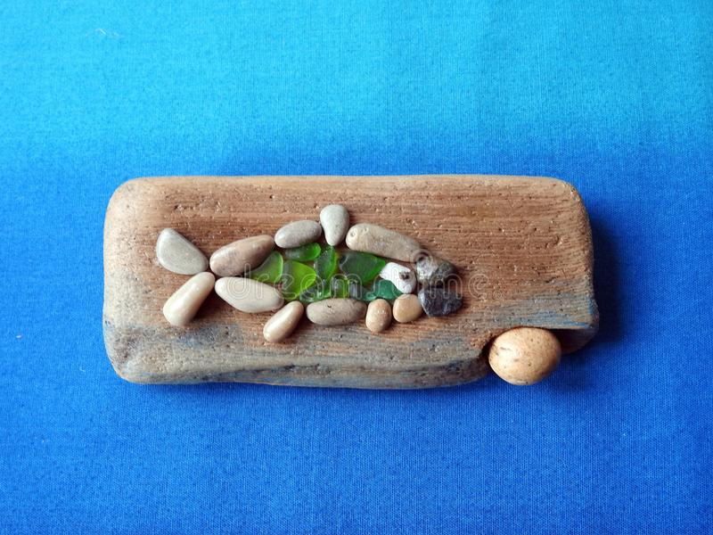Handmade picture - fish on wooden surface, Lithuania stock photos