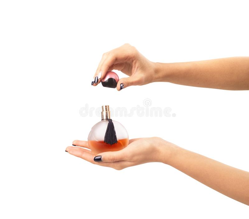 Beautiful hands keeps the spirits isolated. Perfume, cosmetics c royalty free stock images