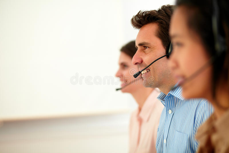 Beautiful and handsome operators giving service stock images