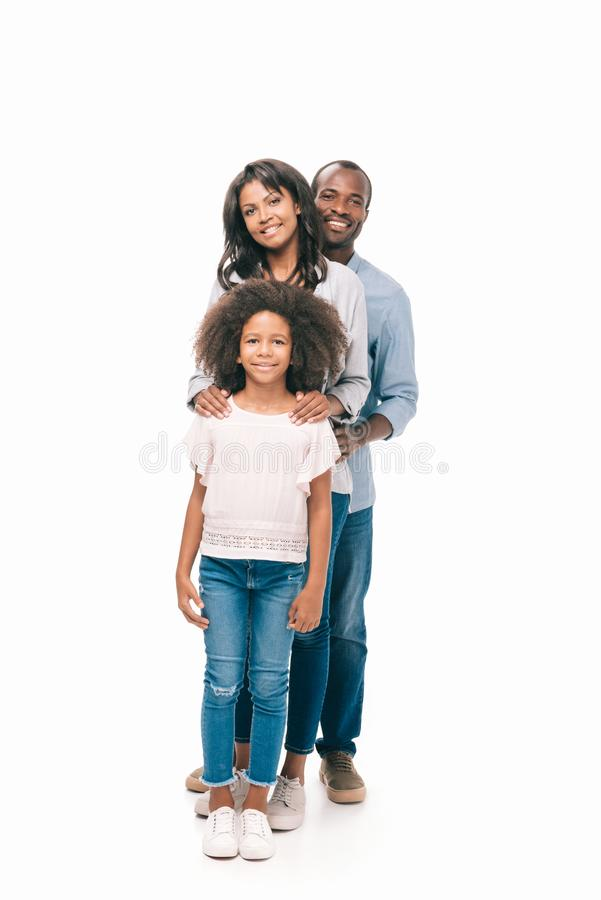 Beautiful happy african american family with one child standing together. Isolated on white stock photo