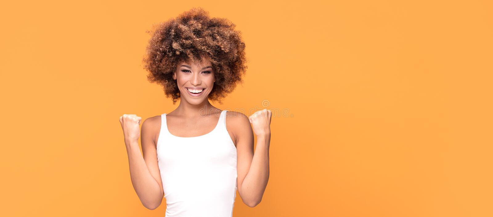 Beautiful happy african american woman celebrating victory. stock images