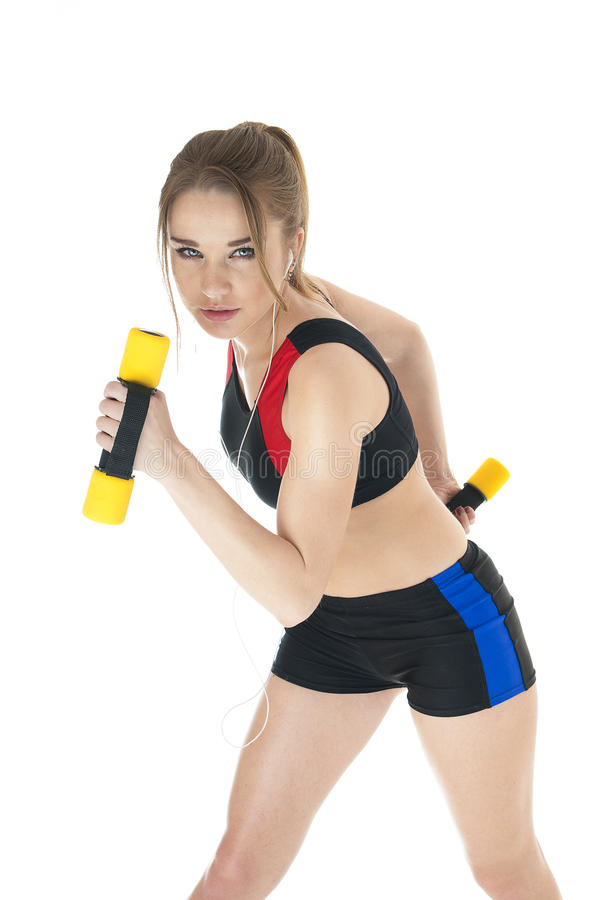 Beautiful happy athletic girl with dumbbells. royalty free stock photography
