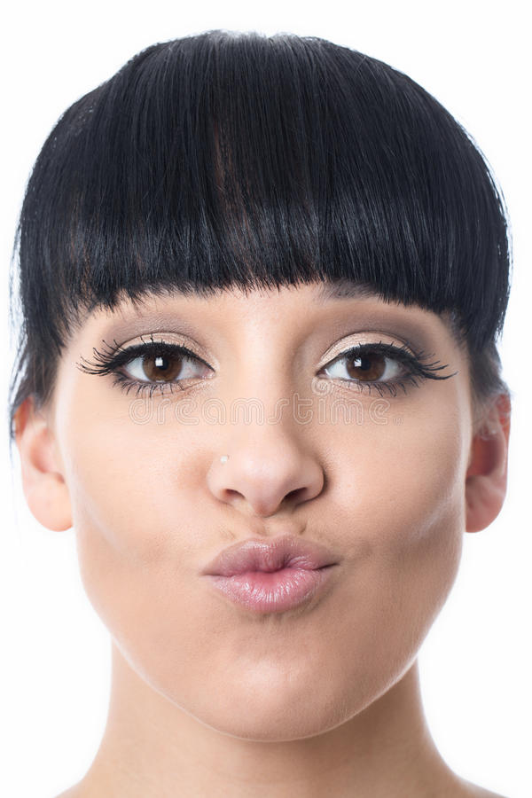 Beautiful Happy Attractive Young Woman with Pouted Lips. Beautiful happy attractive Young Woman with black hair and hispanic or european features, looking at stock photography