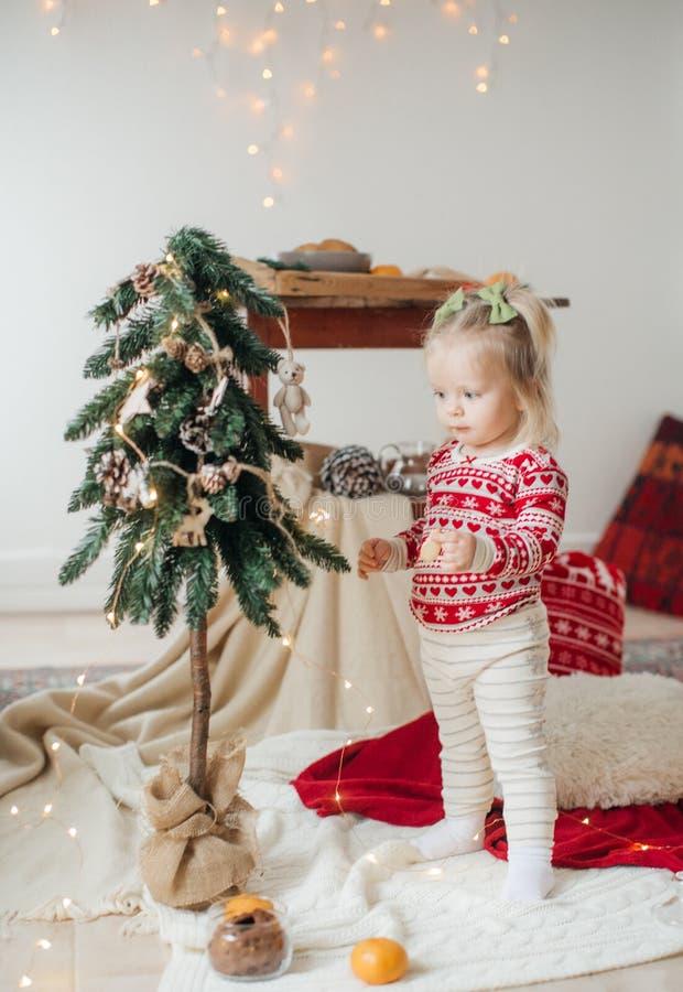 Beautiful happy  baby girl  near Christmas tree royalty free stock photography