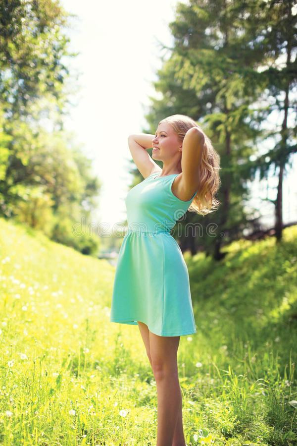 Beautiful happy blonde woman in dress at sunny spring royalty free stock images