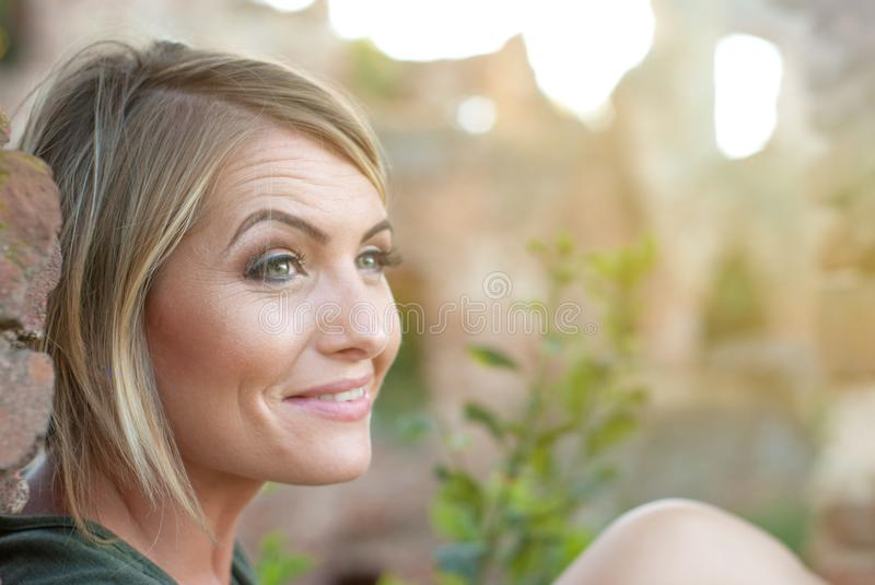 Beautiful happy blonde woman smiling royalty free stock photo