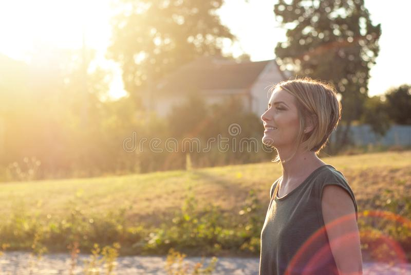 Beautiful happy blonde woman smiling stock photo