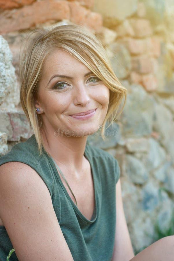 Beautiful happy blonde woman smiling stock image