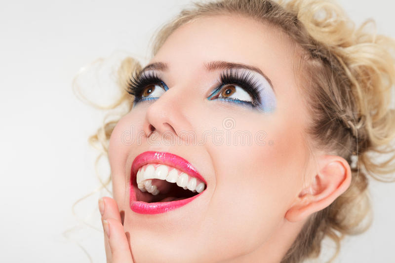 Beautiful happy blonde young woman stock photos