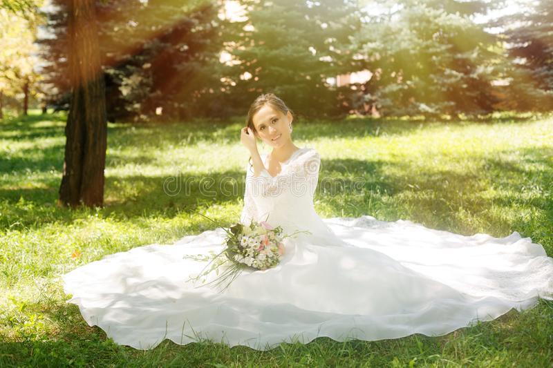 Beautiful happy bride with bouqet stock photo
