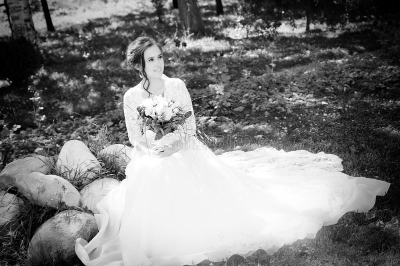 Beautiful happy bride with bouqet royalty free stock photo